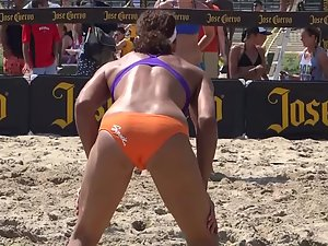 Butts and butt cracks during beach volleyball match