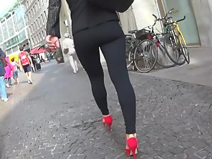 Hot woman in all black and red high heels