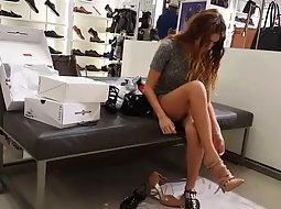 Gorgeous girl tries out new shoes