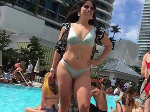 Voyeur examines a sexy latina on a pool party