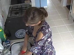 Exposed boob while doing the dishes