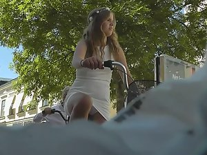 Upskirt of hot girl riding the bicycle