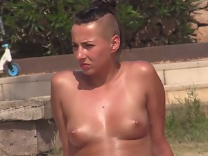Topless girl with half of her head shaved