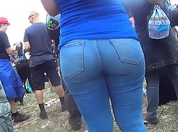 Her bubble butt sticks out of crowd