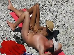 Cute girl wanks a guy on the beach