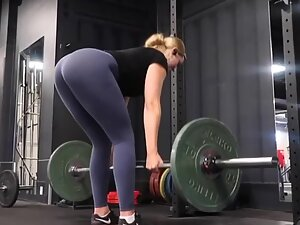 Fit girl's ass during a serious gym workout