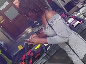 Curly black girl looks amazing in all grey outfit