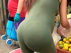 Thong of a pregnant woman in tight outfit