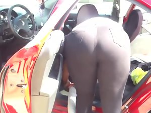 Big ass bends over while cleaning the car