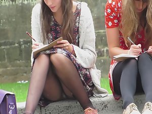 Upskirt of schoolgirl doing homework