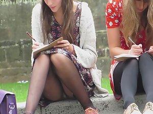 Upskirt of college girl doing homework