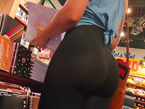 Perfect bubble butt of woman browsing school supplies