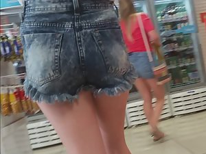 Delicate young ass in too big shorts