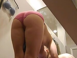 Nice thick ass in pink panties caught in fitting room