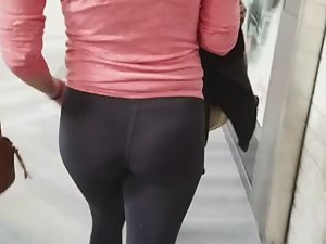Strong blonde's thong is visible inside tights