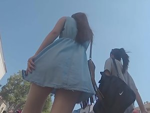 Teen girl is too late to cover up her ass in upskirt