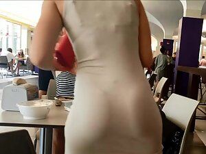 Tight dress reveals thong and tight butt cheeks