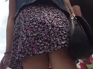 Short skirt reveals ass when it bounces off