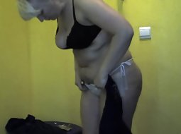 Chubby milf undresses for tanning