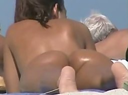 Bubble butt naked on the beach