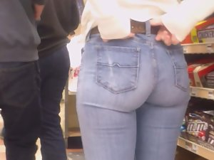 Sexy moment of tugging jeans