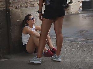 Cute teen sitting on street