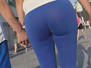 Sexy butt in transparent blue tights