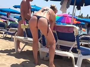 Hot milf on beach makes thoughts drift to sex