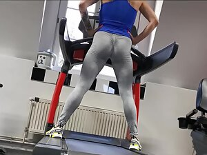 Very muscular ass doing sprints on treadmill