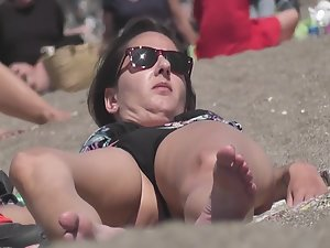 Voyeur zooms on pubic mound in bikini