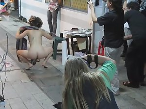 Naked street art performance