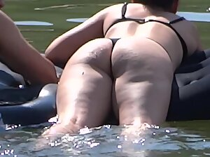 Ripe mature ass floats in the water