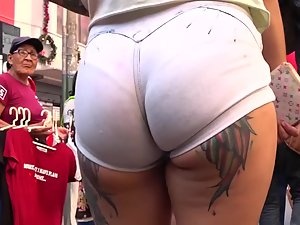 Tattooed ass with a wedgie in white shorts