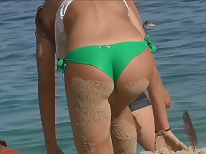 Cameltoe of amazing young pussy in wet bikini