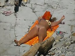 Hot nudist girl tans on the beach