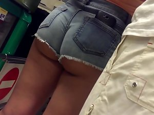 Half naked ass cheeks in shorts