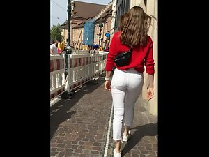 Slightly visible thong under tight white pants