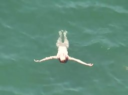 Hot woman spied while floating
