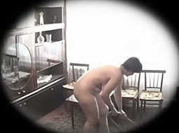 Busty mature lady cleaning the house