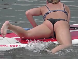 Pussy slip of hot girl on surfboard