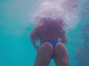 Amazing ass seen underwater during swimming