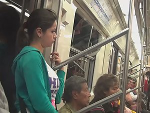 Yummy tits and ass of girl on train