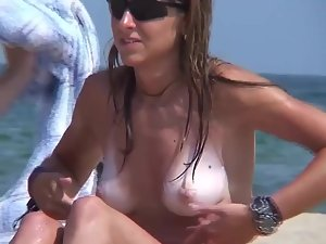 Pale tits and shaved burger pussy on nudist beach