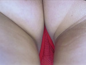 Red thong barely covers shaved pussy